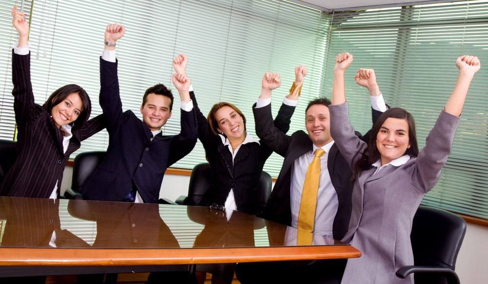 business team at the office all celebrating their success.jpeg